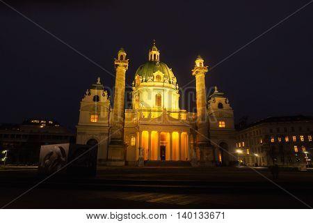 Illuminated St Charles Church at night, Vienna, Austria with dark sky