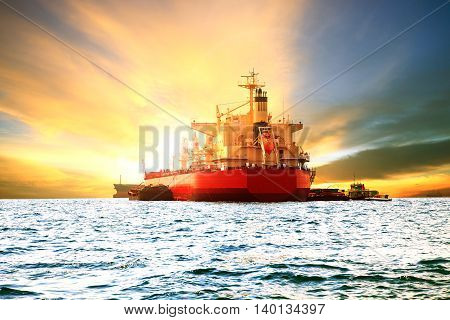 container ship loading goods product at sea harbor port against beautiful sun light sky