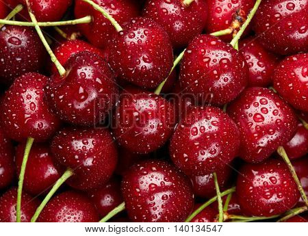 Cherry Background. Sweet organic cherries with waterdrops on market counter