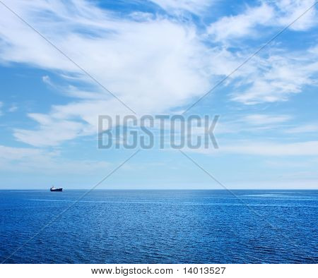 Alone ship in blue sea
