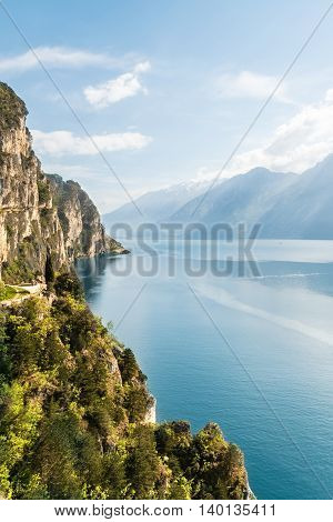 Panorama of the gorgeous Lake Garda surrounded by mountains in Riva del Garda Italy.