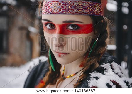 american indian girl with makeup in winter