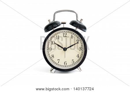 Isolated black vintage alarm clock on white background
