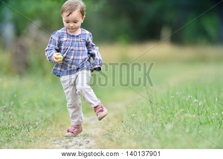 Little girl running in country path