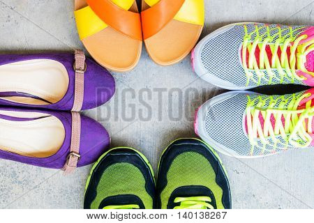 Men and women running shoes and fashion shoe on floor background