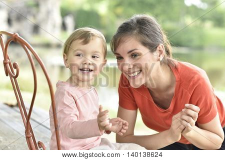 Portrait of cheerful mom and daughter laughing outloud