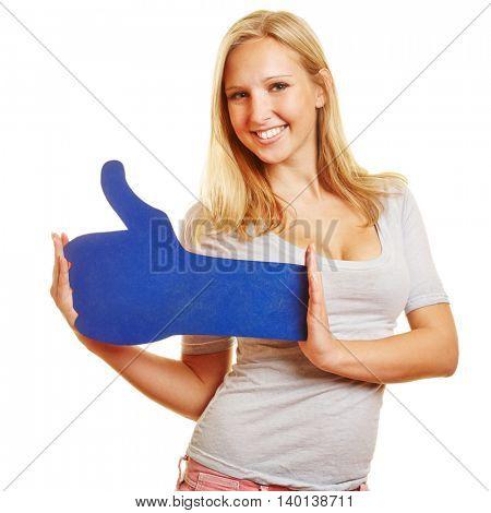 Smiling happy woman holding a big blue social media thumb up
