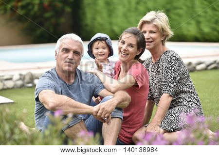 Family enjoying summer day in yard
