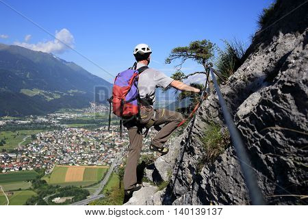 sport climber is viewing to the valley