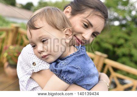 Little girl giving her mom a hug