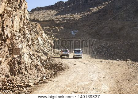 Sani Pass, South Africa - July 15, 2016: Cars are doing off-road trail on Sani Pass.