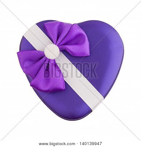 Metallic purple gift box shape heart with a bow isolated. Top view