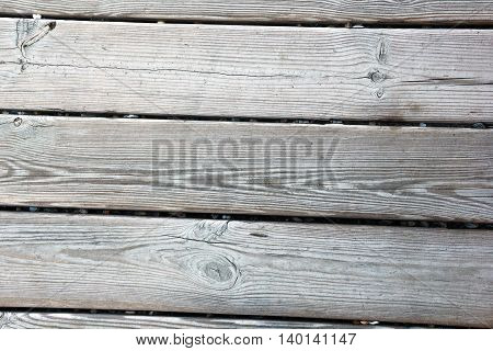 the striped grey wooden planks as background