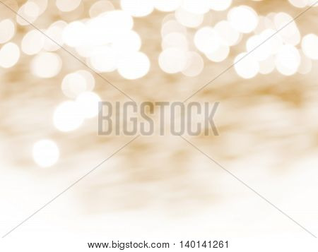 gold abstract blurred background with white bokeh