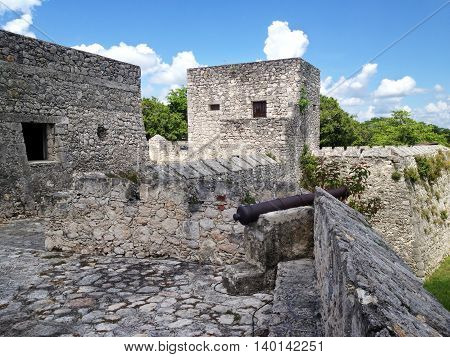 Old cannon on the wall of the fort of San Felipe in Bacalar Lagoon Mexico