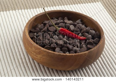 chocolate chips and chili on the wooden bowl