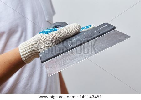 men with putty knife