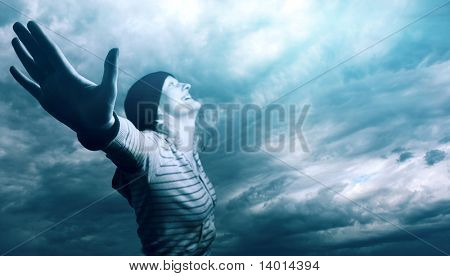 Young woman over cloudy sky. Focus on hand