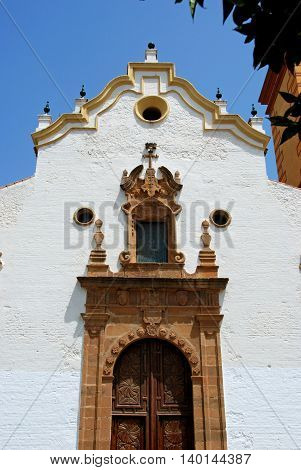 Front view of the church with an ornate door (Iglesia de Nuestra Senora del los remedios) Estepona Malaga Province Andalucia Spain Western Europe.