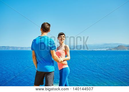 happiness couple stay over the sea under sky