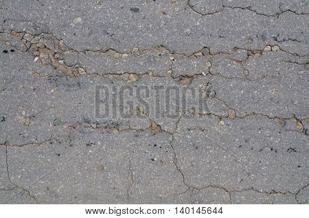 Macro closeup on concrete asphalt cracks on the road