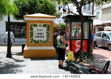 ESTEPONA, SPAIN - JULY 18, 2008 - Lottery kiosk and people in the Plaza Antonia Guerrero Estepona Malaga Province Andalusia Spain Western Europe, July 18, 2008.