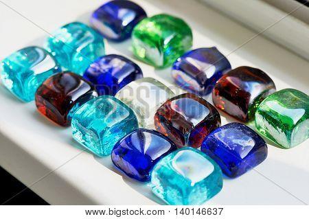 Bright glass multicolored glass stones square. Macro