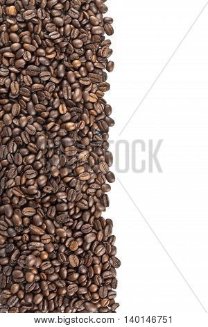 roasted coffee beans on a white surface