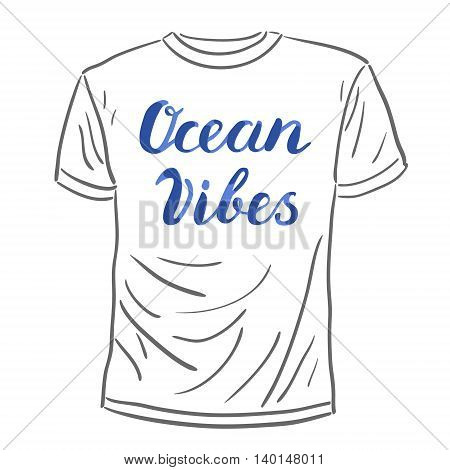 Ocean vibes. Brush hand lettering. Handwritten words on a sample t-shirt. Great for beach tote bags, swimwear, holiday clothes, and more.