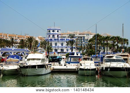ESTEPONA, SPAIN - JULY 18, 2008 - View of boats and yachts in the marina with the harbour masters office to the rear Estepona Malaga Province Andalusia Spain Western Europe, July 18, 2008.