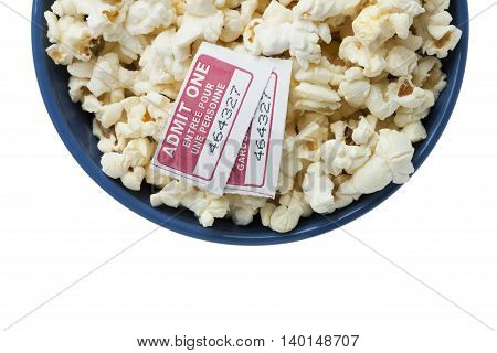 bowl with popcorn and two movie tickets
