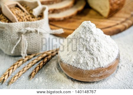 wheat and flour on the table