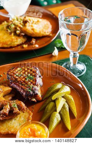 grilled meat with potato pancakes