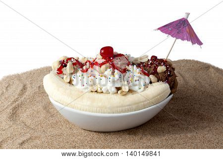 a plate with banana spit sundae and whipped cream top with cherry