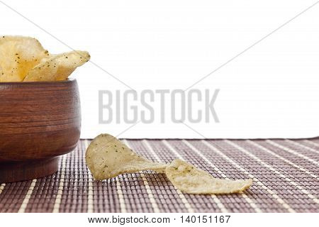 crispy sour cream and onion potato chips in wooden bowl