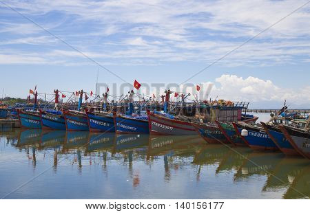 Hue, Vietnam - Jun 20, 2016: Vietnamese wooden fishing boat anchoring at a harbor to avoid hurricane storm on a shore in Thuan An. Vietnamese fishermen used to be harassed by Chinese marine police.