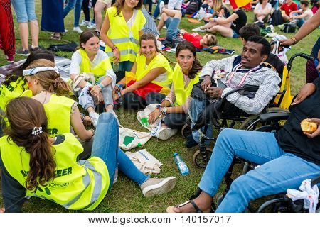 Poznan POLAND - JULY 24 2016: pilgrims resting during Days In Dioceses just before The World Youth Day in Krakow; WYD is a meeting of youth from all over the world