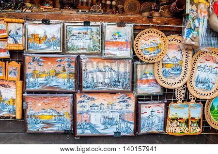 VELIKY NOVGOROD RUSSIA-JULY 22 2016. Colored paintings of birch bark with Slavic landscapes and landmarks of Veliky Novgorod. Traditional Russian handmade objects. Souvenir trade.