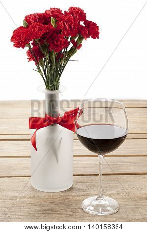 red peony and wine glass decorated in wooden table