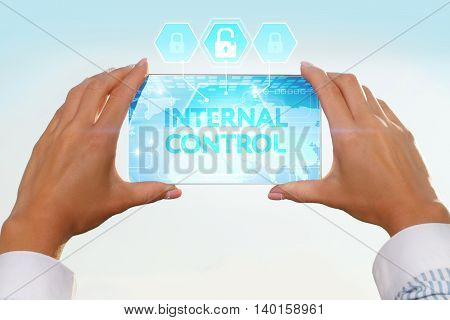 The Girl Looks At A Virtual Screen Of Your Smartphone. Text Internal Control.