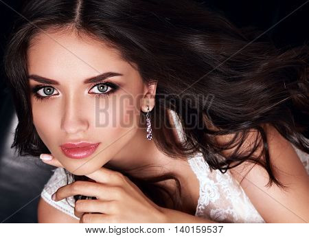 Beautiful Makeup Woman With Pink Lipstick And Long Curly Hair Posing In Fashion Earrings. Closeup Po
