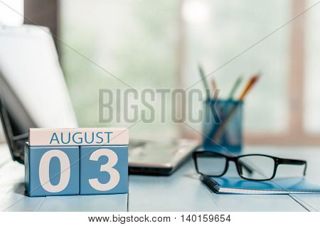 August 3rd. Day of the month 3 wooden color calendar on business workplace background. Summer time. Empty space for text.