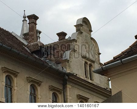 Romania, August 21, 2015, Sighisoara, Transylvania, Architecture details in the old houses' roofs and windows frames