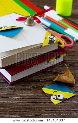 The Child Makes The Book Bookmark Cartoon Character Mignon. Glue, Scissors, Paper And Autumn Leaves