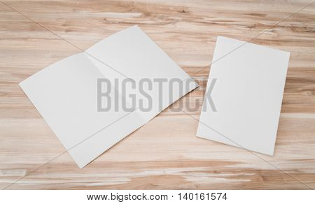 Bifold white template paper on wood texture