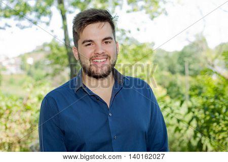 happy young casual man outdoor portrait