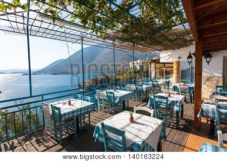 Bali, Island Crete, Greece, - June 23, 2016: The tables in the restaurant with view on the Mediterranean Sea and mountains