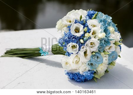 beautiful wedding bouquet of white and blue roses