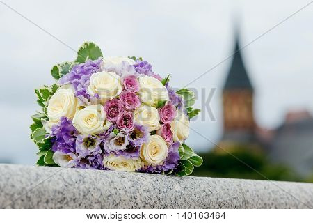 beautiful wedding bouquet of the bride of roses