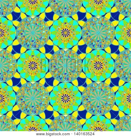 Green fractal diamond on a background of blue yellow leaves seamless pattern.